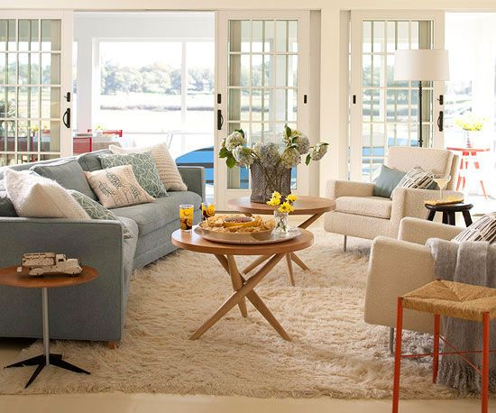 Living Room Arranging Tips: Within Reach  Put a table within reach of each seat. Use round pedestal tables as side tables between chairs and sofas. The curves of round tables make them easier to navigate around. When space is tight, use nesting tables for flexible use when needed.
