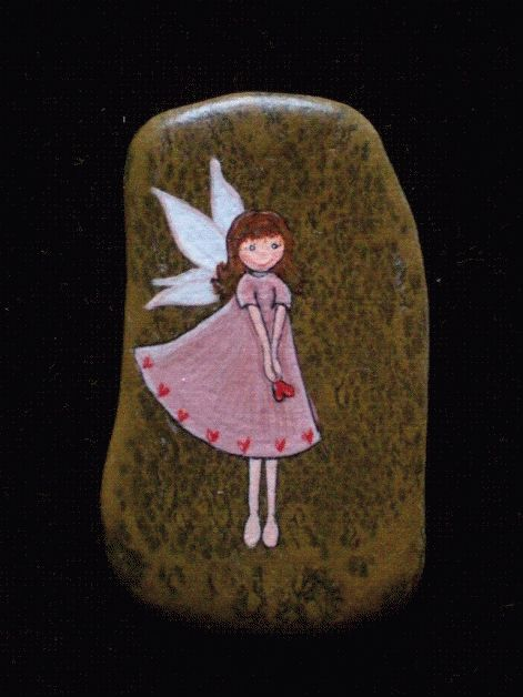 cute fairy painting on a rock