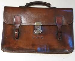 I pulled out a brown leather briefcase with two handles. Tiny scratches etched the worn surface, and a deep gash ran across the front flap like a scar along a prize-fighter's arm. (p. 3)