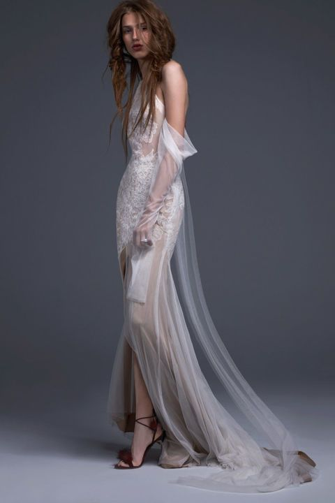 Light ivory French tulle halter off the shoulder gown with draped sleeves accented by hand placed Chantilly lace applique and front slit.