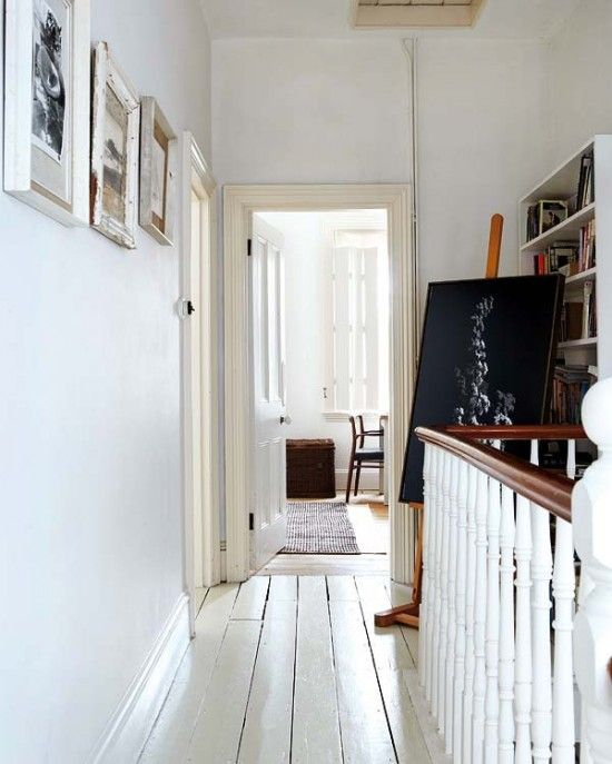 Victorian house with original period features and painted floorboards in hallway