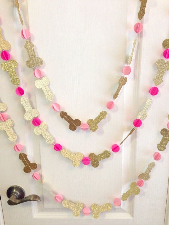 Our handmade paper penis garlands are unique and one of a kind! Decorate your Bachelorette Party or Hen Party with this glitzy, glitter penis banner offered in a variety of colors and even custom options. These look great layered over doorways or fireplaces, or even strung in multiples to create a door curtain! Each garland is sewn with 12 double-sided glitter penis cutouts and 13 card stock cutouts of your choice. Garland is approx 55-60L with cutouts approx 2W. We leave plenty of thread at…