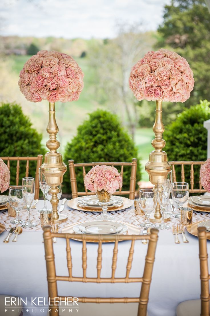 Luxury wedding table-scape of pink Creole carnations paired with gold candlesticks and pedestal vases. Design by J. Morris Flowers