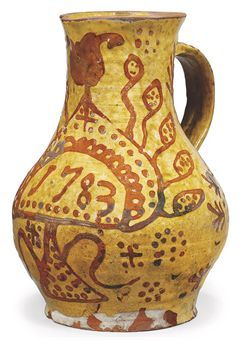 A SLIPWARE DATED BALUSTER JUG  1783 probably Ewenny