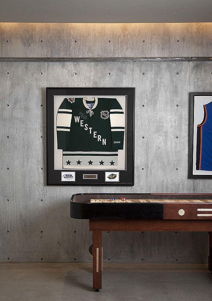 Game on! Modern rec room w sports memorabilia by Ryan Street.