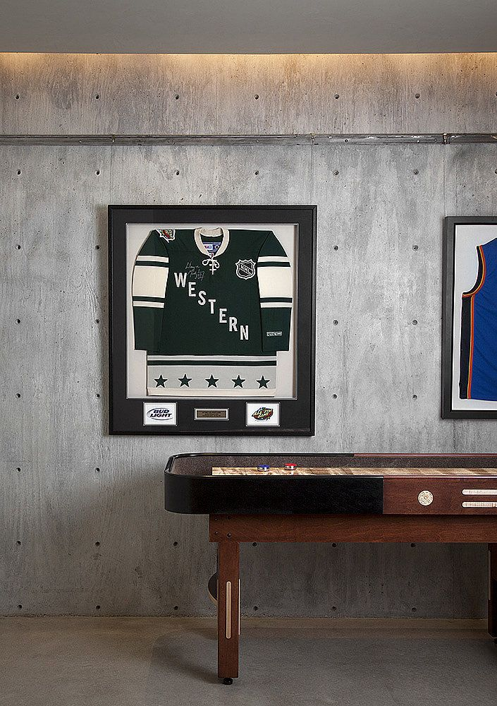 Game on! Modern rec room w sports memorabilia by Ryan Street.