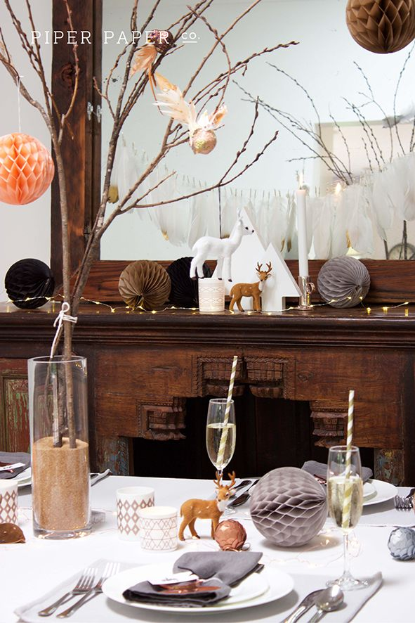 Check out this modern take on a Christmas Table Setting, Centerpiece and Mantle Decorations. The copper and peach really add a pop of colour to the muted sophisticated palette.