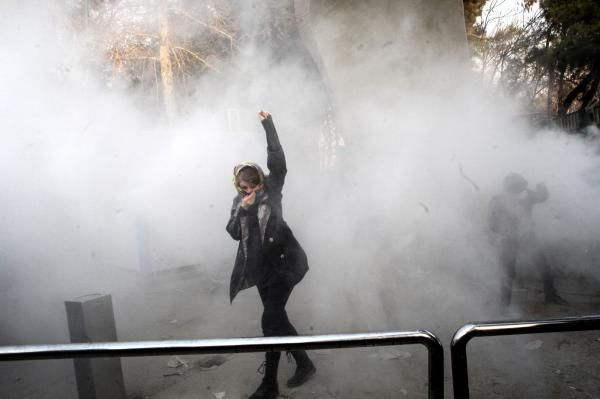Two people were killed and Iran's government limited access to various social media applications amid ongoing anti-government protests.