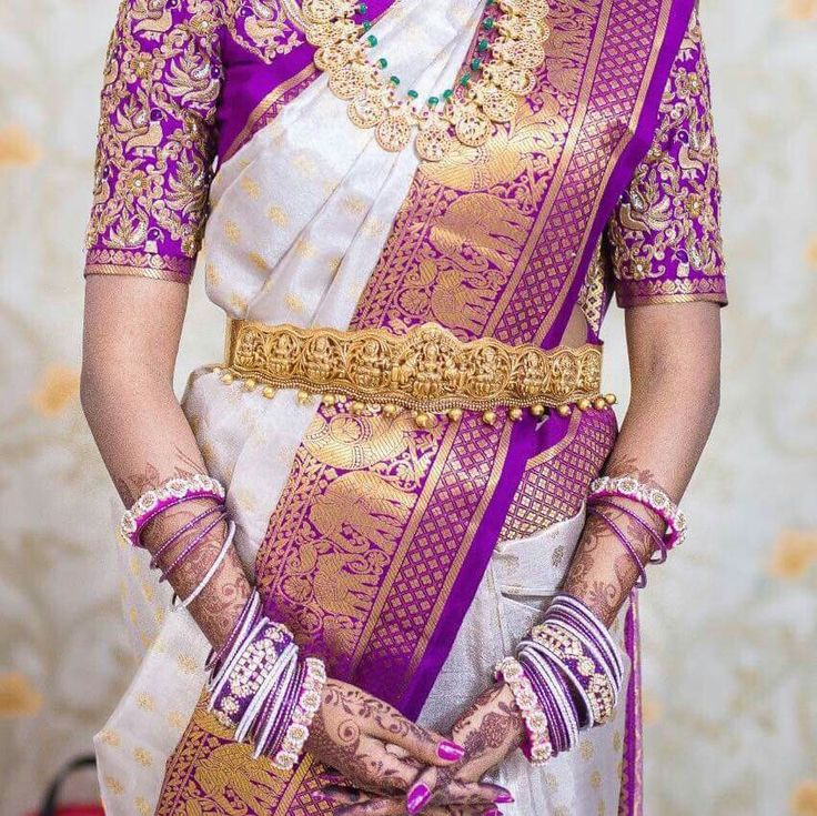 South Indian bride. Diamond Indian bridal jewelry.Temple jewelry. Jhumkis. Purple and white silk kanchipuram sari.braid with fresh jasmine flowers. Tamil bride. Telugu bride. Kannada bride. Hindu bride. Malayalee bride.Kerala bride.South Indian wedding.