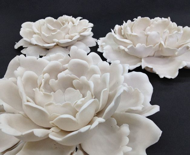 Inspired by nature and the delicate interplay of light, form and texture, each of our porcelain flowers is handcrafted in Brooklyn bytalentedceramic artist...