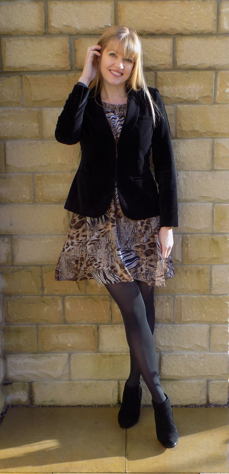 Animal print dress styled for winter with black velvet jacket, black opaque tights and black high heeled ankle boots. Smart dress Day dress Snakeprint dress Reptile print dress Winter dress over 40 style Swing dress