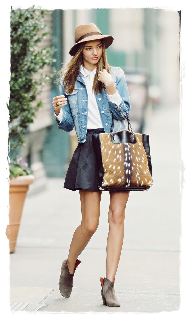 #Miranda #Kerr Handbags Style - Alexander Wang Deer Skin Prisma Tote Bag |  Miranda Kerr shows us how to make a faded denim jacket look smart and polished. She teams her denim jacket with a white collared shirt, black skater skirt, and taupe ankle boots. A light brown hat and animal print tote bag complete the outfit. A tan coloured fedora looks great matched with denim and white for a more laid back approach, and style queen Miranda Kerr shows us exactly how to pull this look off.