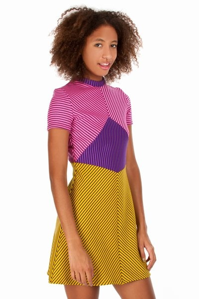 House of Holland  Jersey Tennis Dress  Paneled striped mini dress | High round neck | Flared skirt | 96% wool, 4% Lycra | Made in the UK.