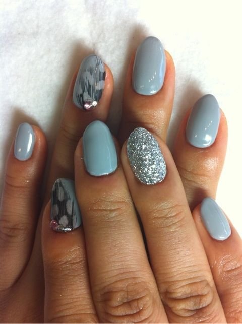 Pretty powder blue feather design.. dont know if i like the rounded nail, but i love the color