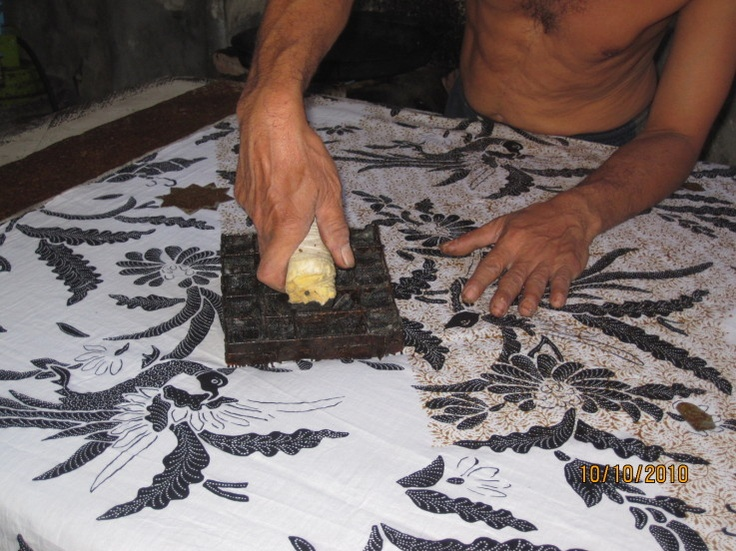 Batik - Stamping wax design onto cloth with stamping tool