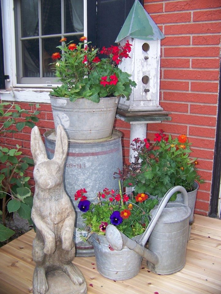 """Carol says, """"Well, of course I love this display - watering cans, flowers and a bunny rabbit!  What more could one want?"""""""