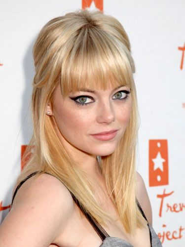 Emma Stone looks like hot sex on a platter! To do, simply tease your roots at the crown, sweep the top and sides of your hair back into an elastic, and leave bangs loose. Pair with major cat eyes, and he's yours.   - Cosmopolitan.com