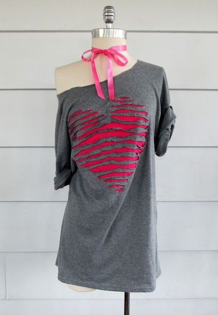 Cute idea to jazz up a boring tee by cutting strips in a pattern (here a heart) and then sewing a contrasting color of fabric underneath.:
