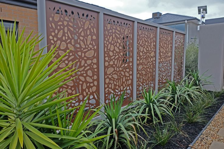 Laser cut decorative screens make a stylish alternative to plain fencing. These are QAQ's 'Cayman' design at a Metricon display home.