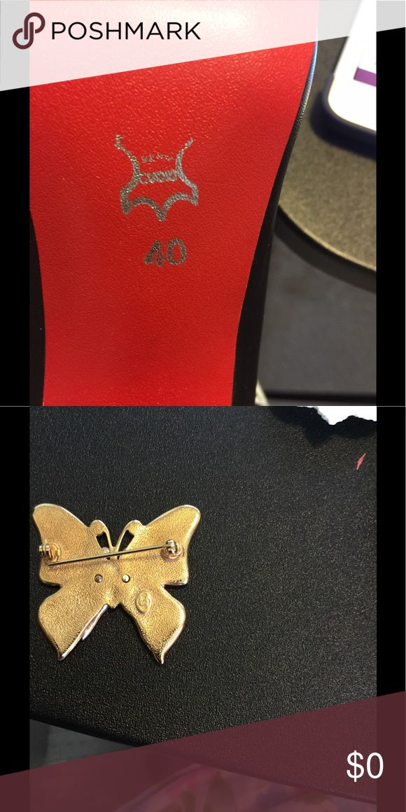 Need help please Does anyone out there knows what the symbol on this butterfly is I have a pair of earrings also with that symbol on it and the symbol on the red shoe what does it mean I've looked everywhere please help if you can. Thank You Accessories