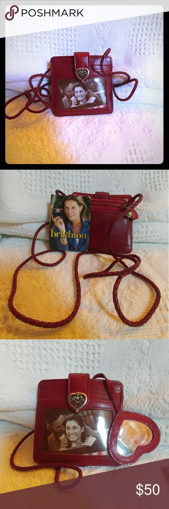 Brighton wallet/coin purse with strap/necklace NWOT - Brand New.  Never used.  Cherry red leather.  Holds coins, credit cards and cash.  Has attached heart shaped mirror.  Perfect for events where a larger purse is a pain it for every day.  Very cute. Brighton Bags