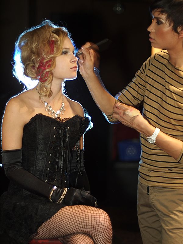 Makeup Artist Chevi Rabbit applying makeup at a fashion show in Edmonton in 2012.