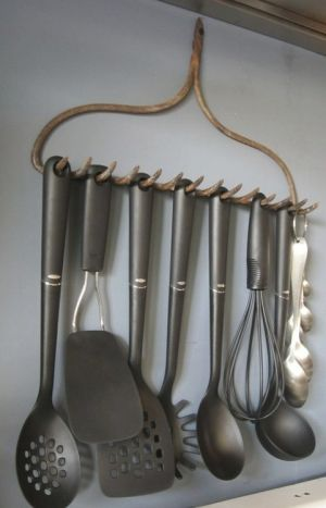 Old rake recycled into kitchen accessories holder - I love the idea of hanging utensils.