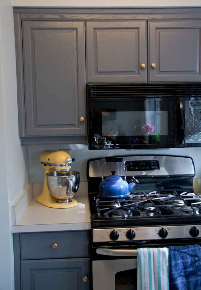 Glitter And Goat Cheese Dark Gray Cabinets With Gold