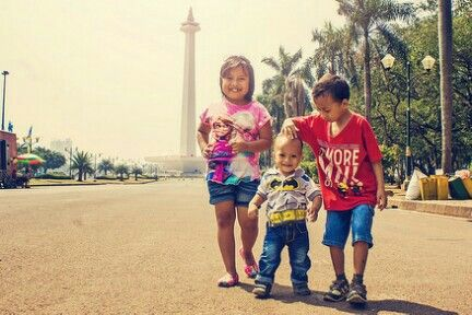 Elsa, batman, minions are siblings. They go to MONAS, Jakarta Indonesia