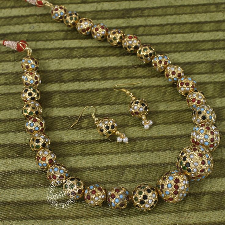 mughal inspired jewels features this Bollywood piece Studded With Simulated Navaratan Pearls Turquiose,Coral,White ,Green Necklace measures : Length (approx) - 15 1/4 Inch with adjustable cord fit to all neck size. Earrings - Measures (approx) 45mm-1 3/4