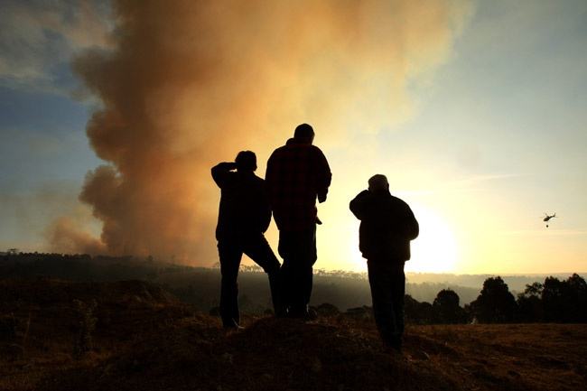 Local residents watch the Churchill-Jerrelang fire as the sun sets over the LaTrobe Valley. Picture: Stuart McEvoy