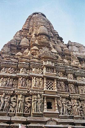 The Khajuraho Group of Monuments in Khajuraho, a town in the Indian state of Madhya Pradesh, located in Chhatarpur District, about 620 kilometres southeast of New Delhi, is one of the most popular tourist destinations in India. Khajuraho has the largest group of medieval Hindu and Jain temples, famous for their erotic sculptures.