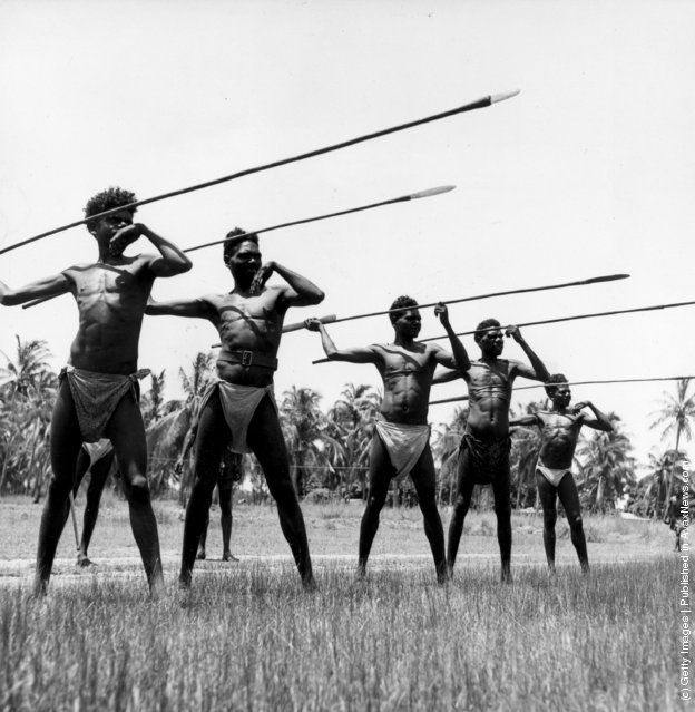 Aboriginal Australians at a spear-throwing contest in Arnhem Land, in the Northern Territory. Woomeras are used in order to throw the 10-foot spears more effectively. (Photo by Three Lions/Getty Images). Circa 1950