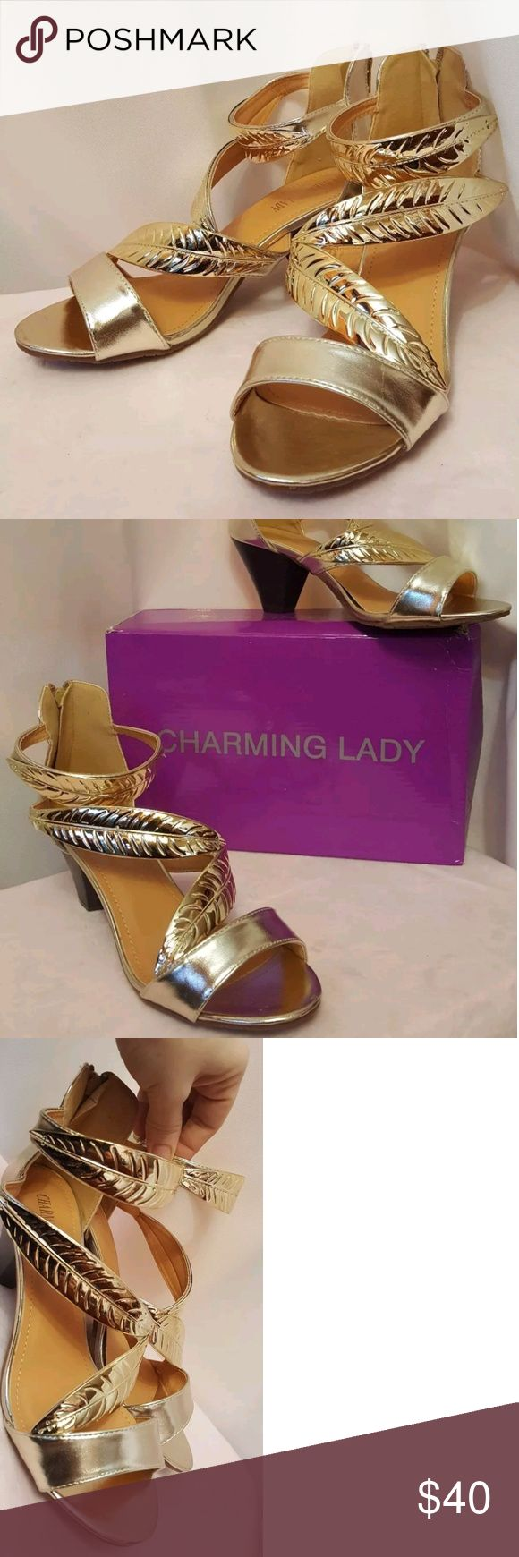 "Charming Lady Gold Etched leaf Strap Heels Size 9 Make a statement in these beautiful metallic leaf etched dress Slip-on sandals. Perfect for the holiday festivities!   Features a 3"" chunky heel, faux leather design, average width.   Deeply discounted price. Retails $99.  Charming Lady Shoes Heels"