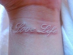 White tattoo... love this!