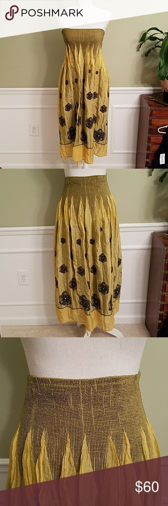 """Anthropologie Lapis Dress Skirt Combo Excellent pre loved condition dress from Lapis.  Can be worn as a dress or skirt with ties at the hem to adjust the length. Size is actually one size on the tags. Color is a gold yellow with chocolate brown stitching. Very stretchy topline. Measurements laying flat are 35""""length , 13.5""""across the chest. Anthropologie Dresses Midi"""