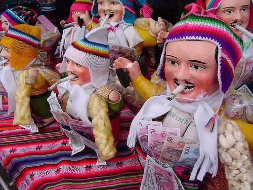 Alacitas;  La Paz, Bolivia;  January 24;  A festival of abundance, dating from Inca times, and dedicated to Ekeko, the household god of agricultural abundance.