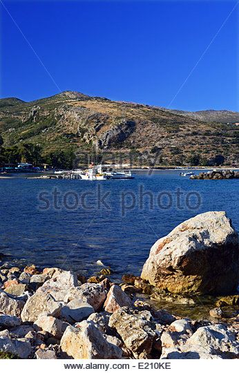 Fishing Boat Tied to Wooden Jetty in Katelios on the Greek Island of Kefalonia - Stock Image