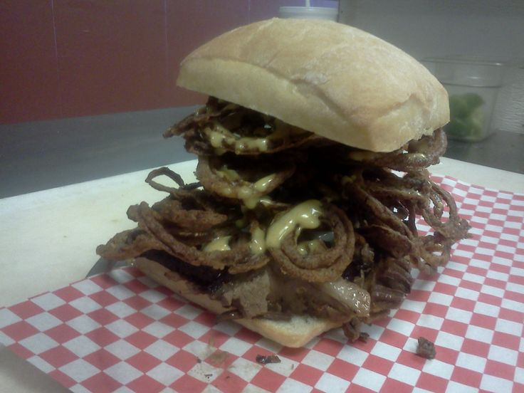 "The Cartwright...beef brisket, monteray jack cheese, onion tanglers and ""Hoss sauce"" on a grilled ciabatta."