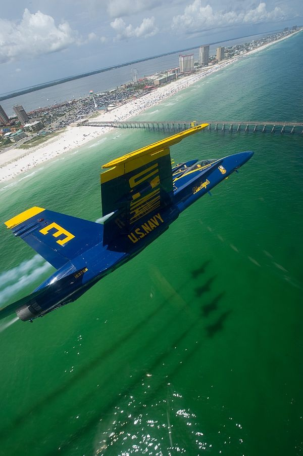 The U.S. Navy flight demonstration squadron, the Blue Angels, perform a practice flight demonstration over Pensacola Beach.