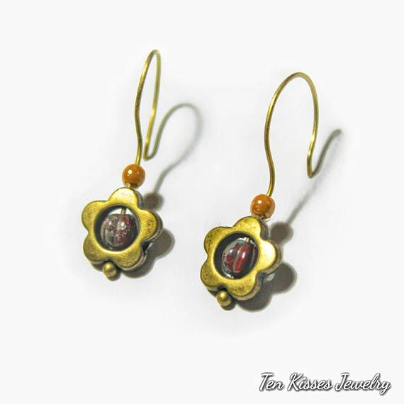 Check out this item in my Etsy shop https://www.etsy.com/ca/listing/570546946/brass-drop-earrings-cute-daisy-vintage
