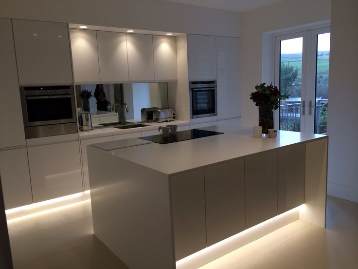 find this pin and more on cocinas white minimal kitchen with ground lighting led