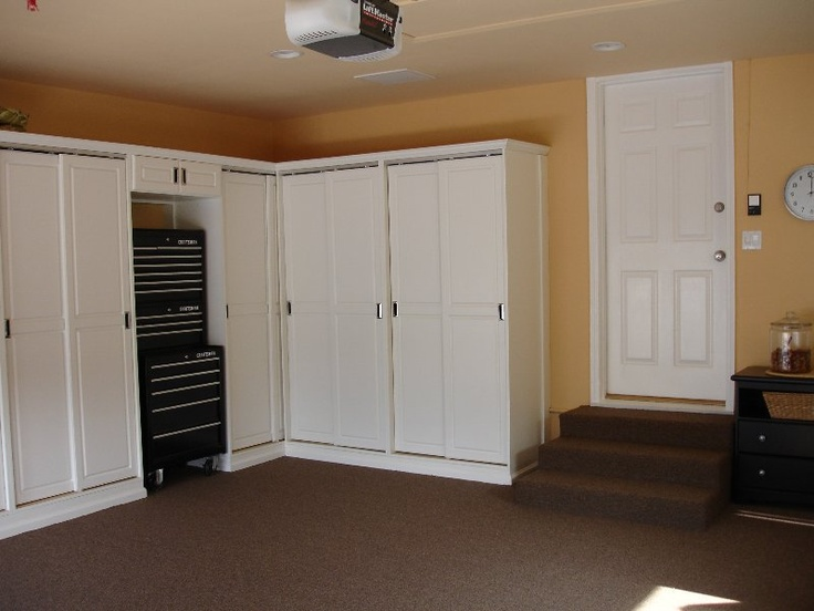 Perfect garage!  I need cupboards like this!  http://aroundrhouse.blogspot.com/2009/12/tablescape-storage.html
