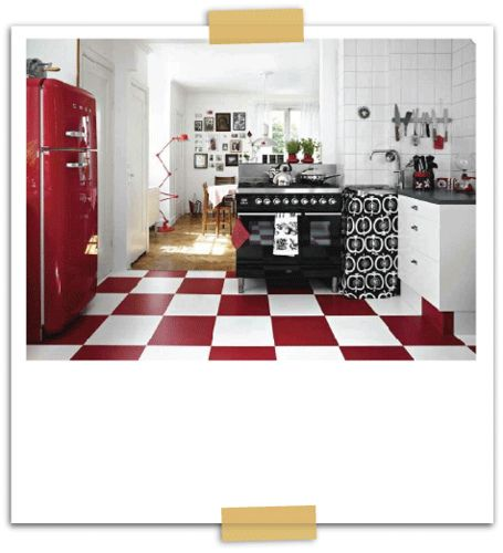 What's not to love? Red fridge, red-and-white checkered floor, black stove...