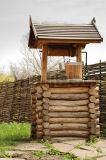 Well. An old well made of integral logs with a wooden bucket