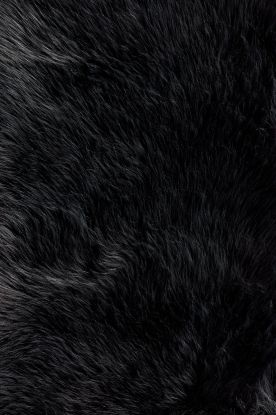 Loloi Danso Black Rug I CHOOSE THIS RUG BECAUSE ITS BLACK AND GOES WITH ANYTHING, I FEEL LIKE THIS RUG WILL STAND OUT IN THE ROOM, WHICH IS A PLUS. AND ITS FAUX FUR WHICH GIVES IT A WARM , COZY FEELING- playroom rug