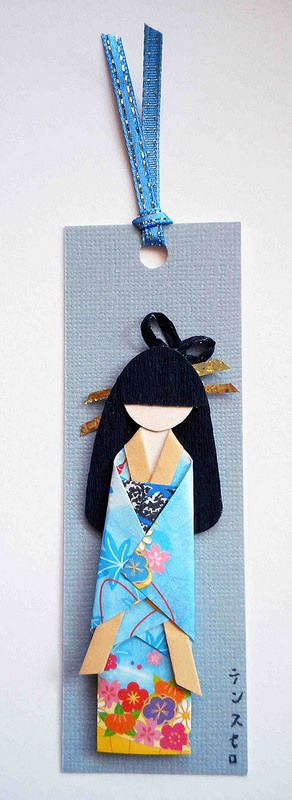 Ningyo bookmark_blue. Bookmark with hand-folded Japanese paper doll mounted on card stock.  Materials: Kimono (origami paper); obi (yuzen washi); hair (crepe paper); hair decor (gold wrapping paper).