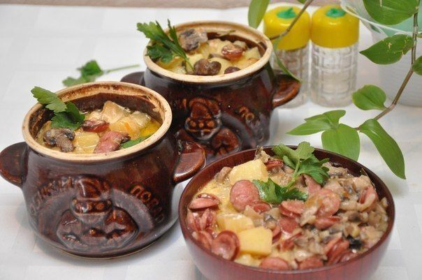 Sausage with potatoes in pots