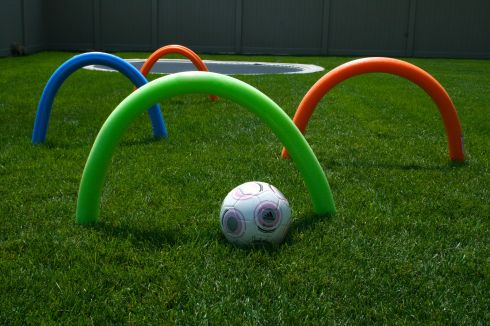 Inexpensive kids party soccer noodle game. Cheap and you probably already have all of the stuff to put it together. Watch the children have fun with this very inexpensive soccer themed party game #soccer #soccerbirthdayparty #inexpensive