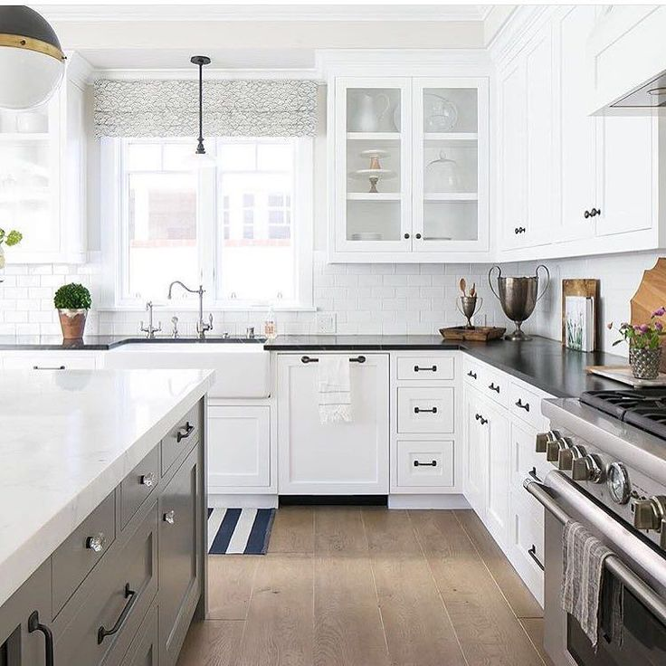 Would love to be spending my Sunday in this lovely kitchen by @kellynuttdesign Loving the island cabinetry color and the soapstone countertops.  #sunday #goodvibes #kitchen #interiors #interiordesign #inspiration #designer #designinspo #white #grey #soapstone #oakfloors by mandyccooper
